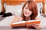 Smiling Woman Writing in Journal